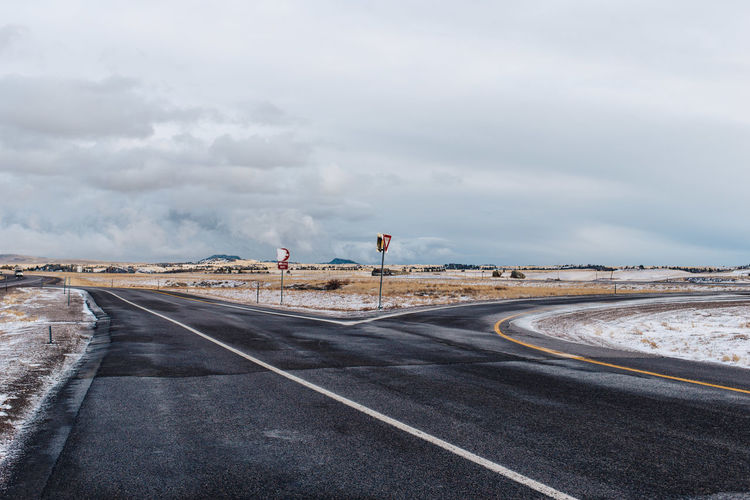 Asphalt Cloud Cloud - Sky Cloudy Country Road Day Diminishing Perspective Empty Empty Road Landscape Long Nature No People Outdoors Overcast Road Road Marking Road Sign Sky Surface Level The Way Forward Travel Destinations Vanishing Point Weather Wyoming