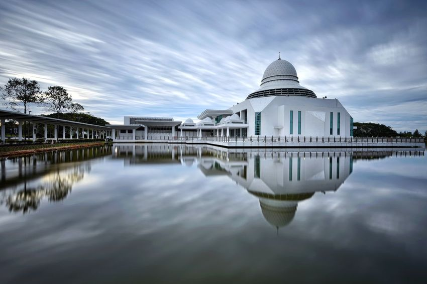 Long exposure sky and mosque reflections over the lake Sunrise Sky And Clouds Skyline Long Exposure View Travel Destinations Beauty Outdoor Landscape Getty Images EyeEm Best Shots EyeEm Selects Beauty In Nature Nature EyeEm Gallery Politics And Government Dome Water Lake Symmetry Reflection City Sky Architecture Historic Place Of Worship Exterior Mosque Religion Spirituality