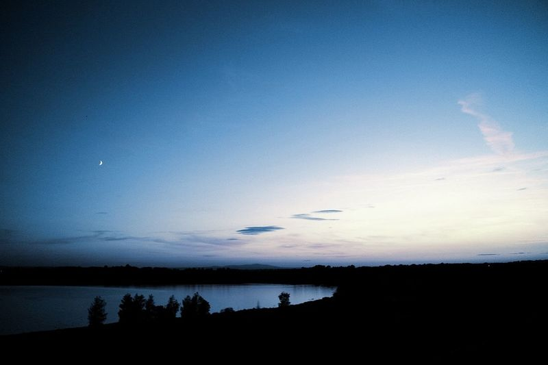 Beauty In Nature Blue Cloud - Sky Copy Space Dusk Environment Idyllic Lake Landscape Nature No People Non-urban Scene Outdoors Scenics - Nature Silhouette Sky Sunset Tranquil Scene Tranquility Water