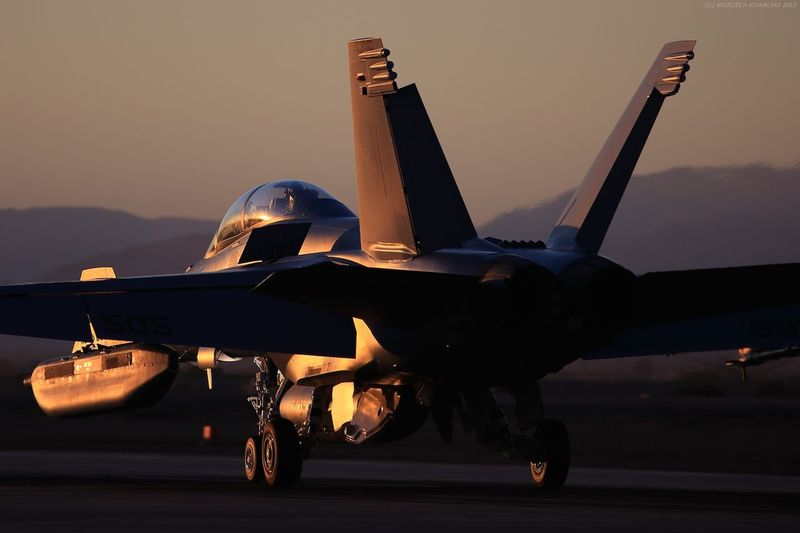 Aerospace Industry Air Force Air Vehicle Airplane Desert Ea-18g Electronic F-18 F-18 Hornet Fighter Fighter Jet Fighter Plane Growler Military Motion Naval No People Orange Outdoors Runway Sunset Technology US Navy USN Warfare