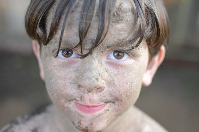 Close-Up Portrait Of Muddy Boy