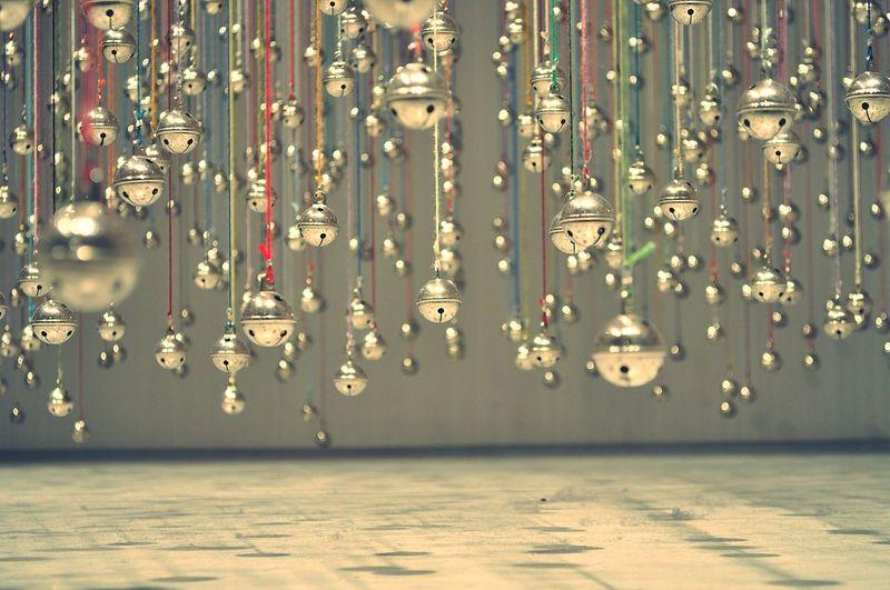 Bells hanging over floor against wall