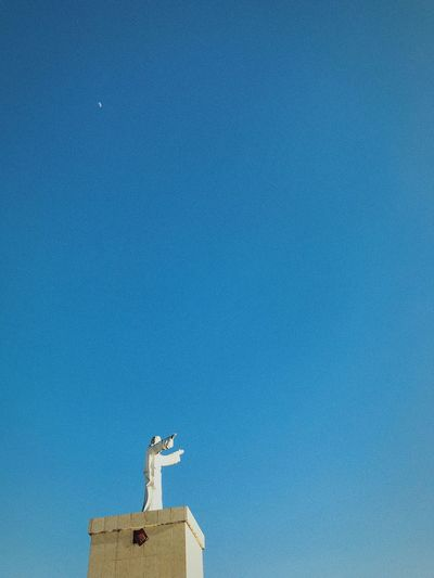 Moon after noon Minimalism Negative Space New Day Hands In The Air Sky Blue Cerulean Blue Bright Colors Bright Sunny Dusk Moonrise Crescent Moon Copy Space Sculpture Statue Blue No People EyeEm Ready   Architecture Day Outdoors Nature Sky