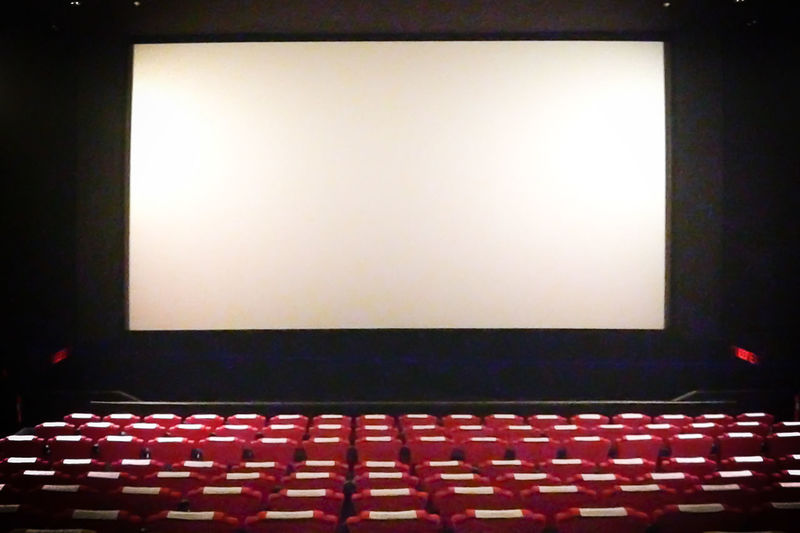 Arts Culture And Entertainment Auditorium Backgrounds Chair Film Industry In A Row Indoors  MOVIE Movie Theater Nightlife No People Premiere Projection Screen Red Seat Stage Theater