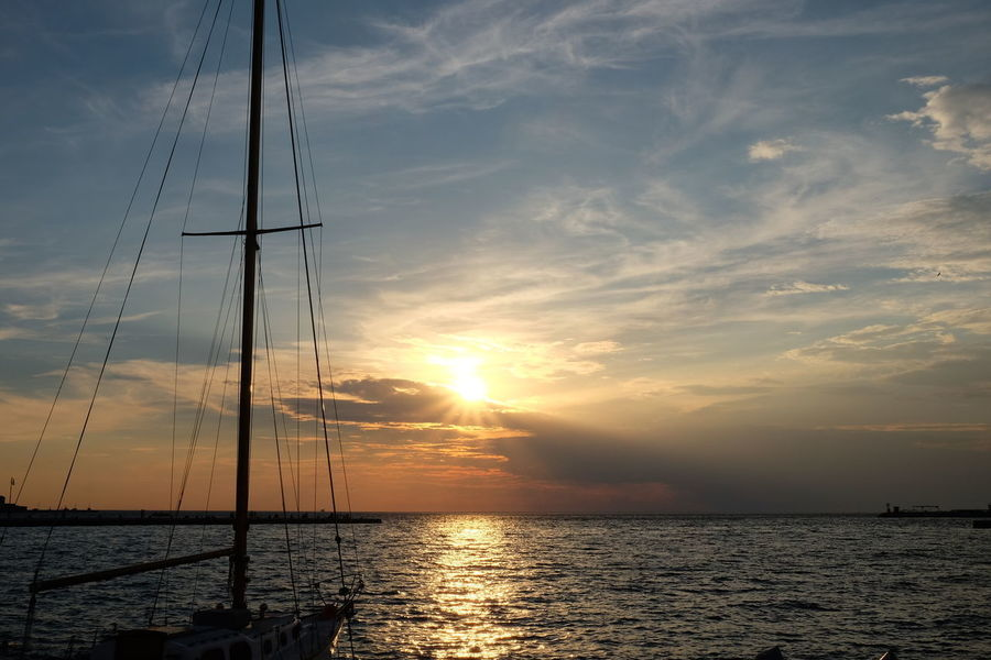 Sunset_collection Beauty In Nature Bright Cloud - Sky Landscape Mast Mode Of Transportation Nature Nautical Vessel No People Outdoors Pole Reflection Sailboat Scenics - Nature Sea Sea And Sky Sky Sun Sunset Tranquil Scene Tranquility Transportation Water Yacht