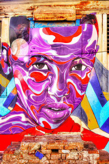 Mural in Kingston, Jamaica Aristic Downtown Kingston Fleet Street Kingston, Jamaica Face Grafffiti Art Mural Painting