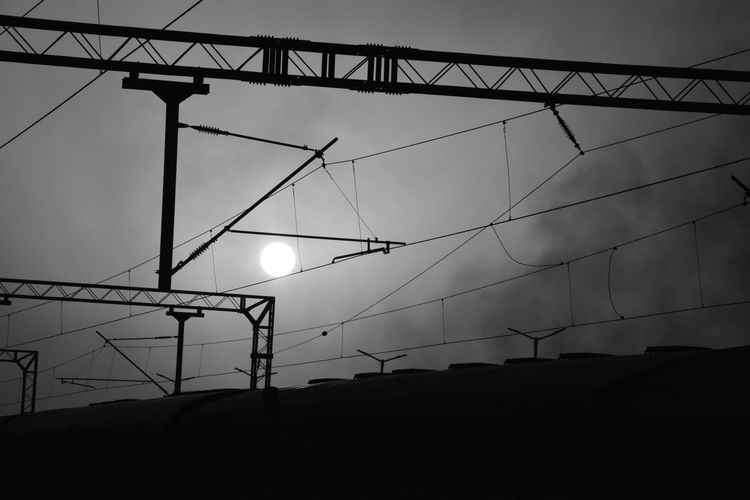 PAUPERISTAION OF NATURE Ruins Architecture Built Structure Cable Complexity Connection Dusk Electrical Equipment Electricity  Electricity Pylon Fuel And Power Generation Indusrty Lighting Equipment Low Angle View Metal Nature Outdoors Power Line  Power Supply Silhouette Sky Sunset Technology Urban