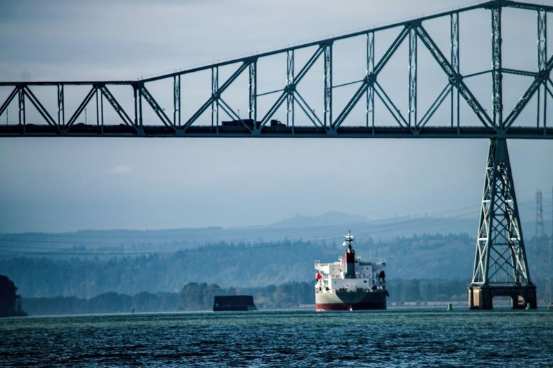 Out To Sea Cargo Ship Under The Bridge Heading Out Darryn Doyle Shipping  Riverscape Check This Out Taking Photos Good Morning World!