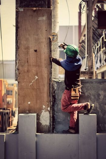 People Human Construction Construction Site Construction Work Construction Worker Hammer Hardhat  Safety Street Sunny Sunny Day Philippines Everydayphilippines One Person Building Exterior Built Structure Architecture Real People