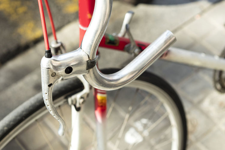 Detail of brake and handlebar of a racing bike. Handlebars Bicycle Brake Close-up Day Focus On Foreground Handle Handlebar Land Vehicle Metal Mode Of Transportation Red Selective Focus Silver Colored Spoke Stationary Transportation Travel Wheel
