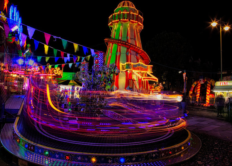 St Giles Fair Light Traces - Childrens Ride Fair Fairground Attraction Funfair Light Trails Night Photography Oxford Childrens Ride Fairground Fairground Ride Fairground Rides Flags Fun Fair Ride Illuminated Light Trace Light Traces Light Trail Long Exposure Motion Multi Colored Night Outdoors People Speed St Giles Travelling Carnival