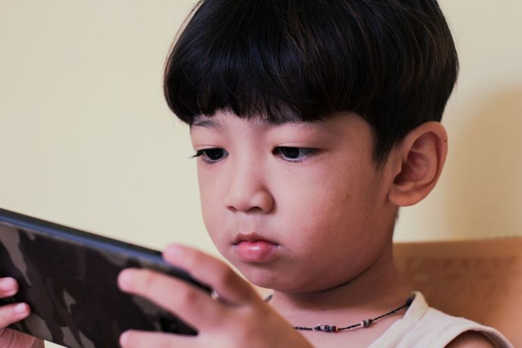 Portrait of boy using mobile phone