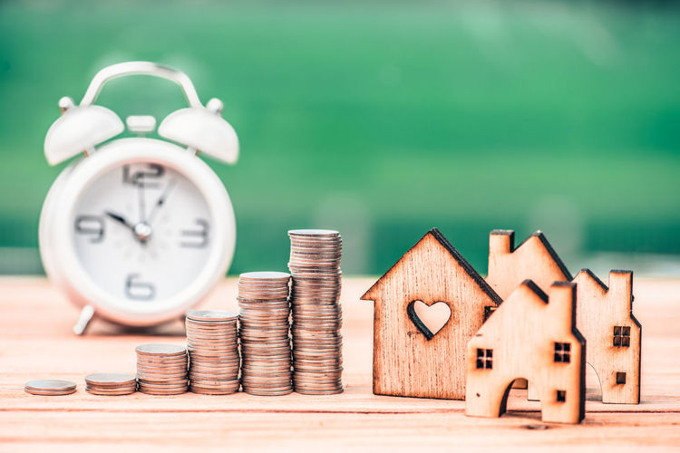 Time Clock Finance Table Still Life Wood - Material No People Alarm Clock Close-up Focus On Foreground Large Group Of Objects Selective Focus Number Coin Indoors  Green Color Business Stack Savings Accuracy Clock Face Economy
