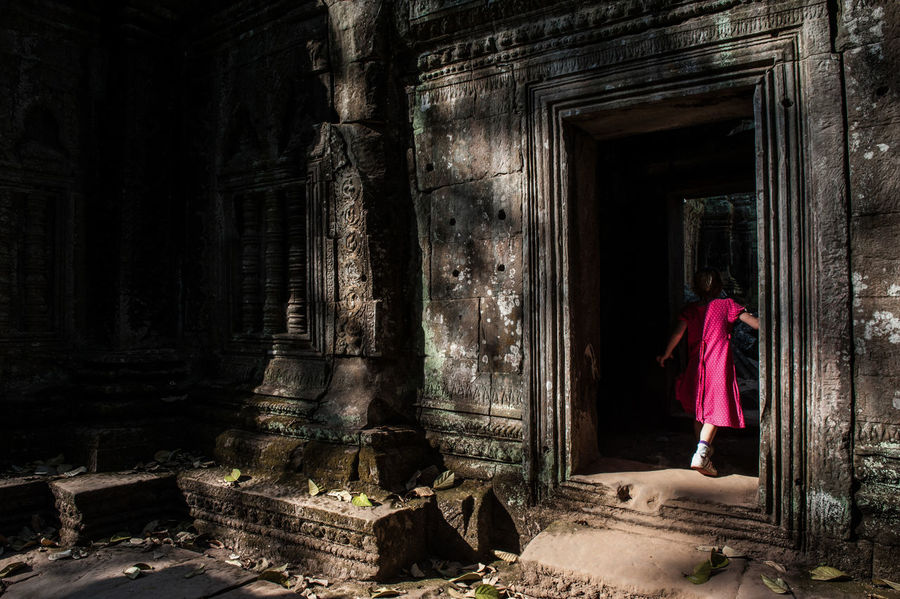 A little girl entering an ancient temple in Siem Reap. ASIA Ancient Structure Ancient Temple Day Full Length Girl In Red Kid Little Girl One Person Outdoors People Real People Standing