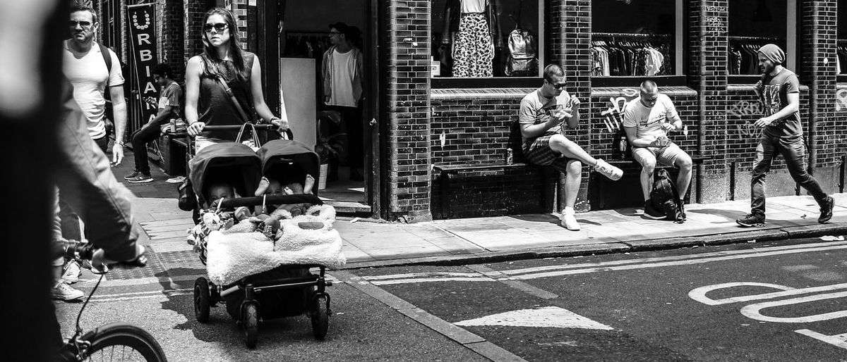 London street life The Street Photographer - 2017 EyeEm Awards London Brick Lane, London Sunday Afternoon Panoramic Black And White Photography City City Life