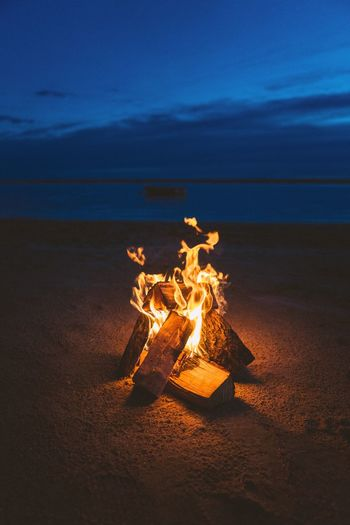 Flame Sand Beach Nature Sea Burning Sky No People Outdoors Scenics Heat - Temperature Night Beauty In Nature Water Horizon Over Water Tranquility Bonfire Close-up Fireplace Fire