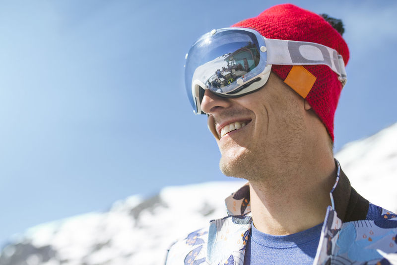 Portrait of smiling man against sky