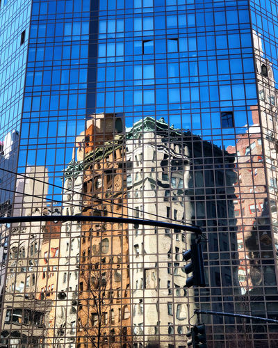 Architecture Built Structure Glass - Material Building Exterior City Building Reflection Modern Day Office Office Building Exterior No People Outdoors Blue Sky Financial District  Skyscraper Sunlight
