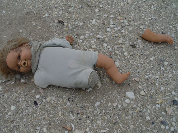 Just a broken doll, found in the sand during low tide, probably thrown off a boat. Imagine a story yourself! 2005 Beach Childhood Day Doll Doll Photography Forgotten Lost Lost Arm Lost Leg Lying Down Outdoors Sad & Lonely Sand