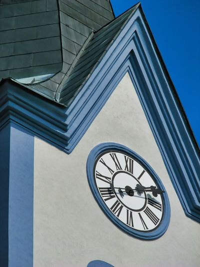 Low angle view of clock against building