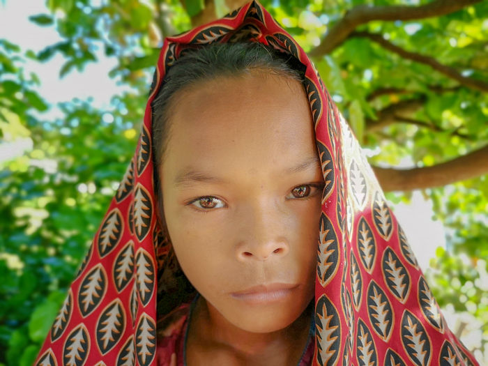 Sea Gypsy Nomadic Ethnic Maiga Island Island Semporna Sabah Malaysia People Sadness Happiness Uneducated Portrait Headshot Looking At Camera Real People One Person Front View Lifestyles Leisure Activity Child Childhood Close-up Focus On Foreground Day Girls Females Tree Nature Outdoors Innocence Human Face Teenager Contemplation
