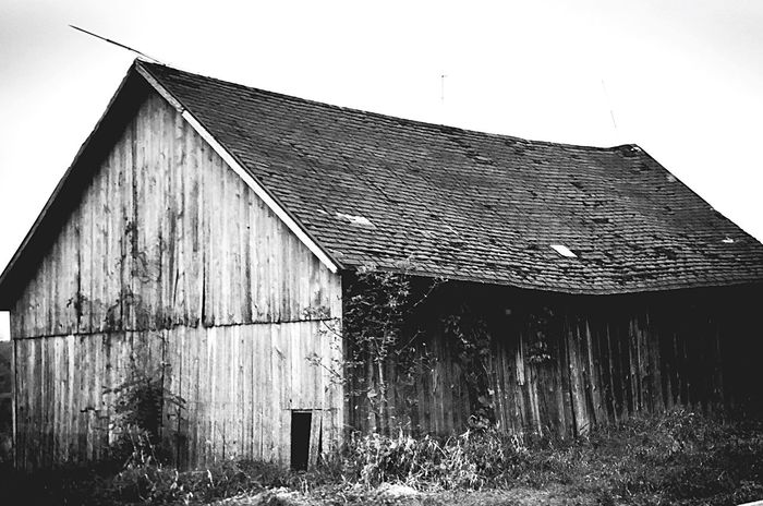Monochrome Photography ▪️Forgotten▪️ Architecture Built Structure House Building Exterior Abandoned Wood - Material Old Barn Damaged Deterioration Obsolete Wooden Bad Condition Weathered Rural Scene Outdoors Day Discarded Sky Exterior Monochrome Photograhy Fresh On Eyeem  Check This Out EyeEm Masterclass