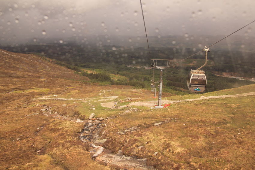 Aonach Mor Cable Car Composition Connection Danger Day Environmental Conservation Farm Field Grass Hill Landscape Lush Foliage Mountain Gondola Outdoors Overhead View Perspective Rain Remote Rural Scene Top Perspective Tranquil Scene Wet Winter It's Cold Outside
