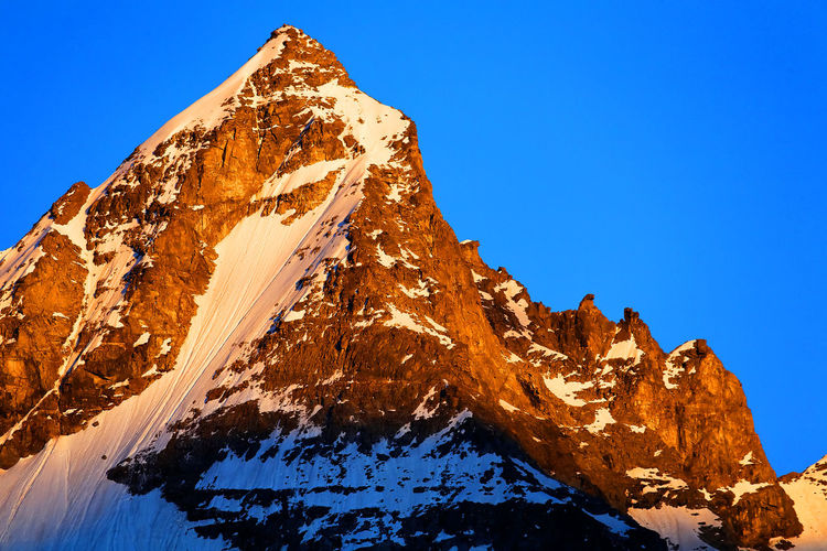 Low angle view of rocky mountain during winter at gran paradiso national park