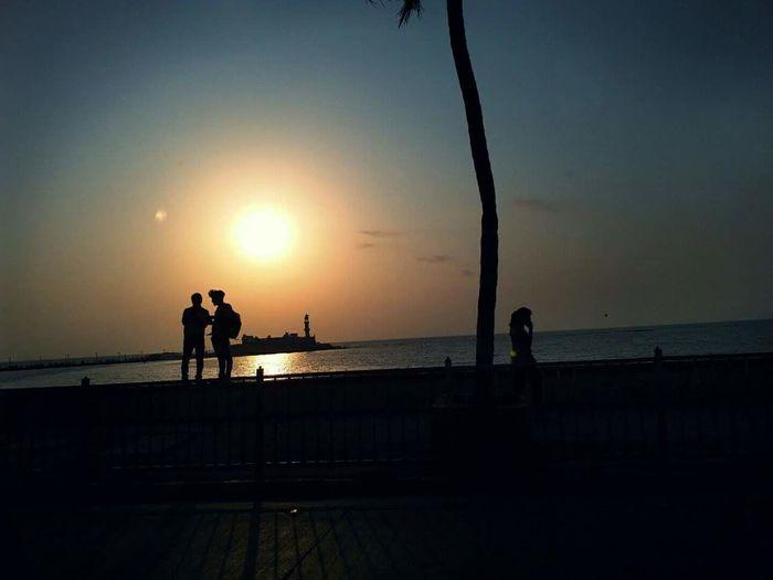 holyland Hajiali MumbaiDiaries Twomen Footpath Water Sea Sunset Beach Men Full Length Standing Silhouette Women Sky Shore Calm Horizon Over Water Pebble Beach Sand Ocean Coastline Lakeside Mid Distance Sun Coast Shining Countryside Sandy Beach