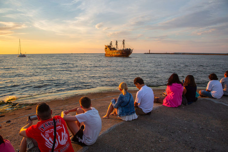 Baltic Sea Boys Child Childhood Cloud - Sky Family Group Of People Horizon Over Water Looking At View Males  Men Mode Of Transportation Nautical Vessel Outdoors Rear View Sea Sitting Sky Son Sunset Togetherness Transportation Water Women