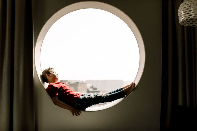 Side view of woman in window