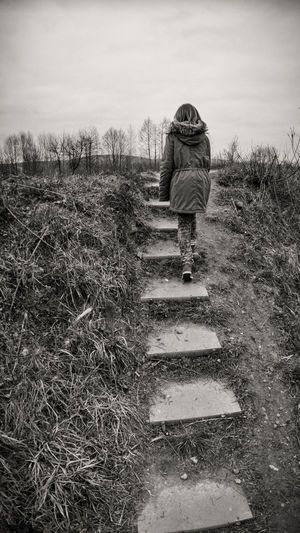 Autumn Tristesse Black And White Day Dull Day Field Girl Grass Landscape Leisure Activity Nature One Person Outdoors People Real People Sky Solitude Steps Walking