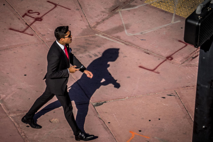 Young Man Adult Aerial Shot Aerial View Businessman Florida High Angle View Men Men In Black MIB Nice Guy One Man Only One Person Patterns Pavement Pavement Patterns People Red Shadow Shadows Shadows & Lights Suit Tie Walk Walk Around Well-dressed