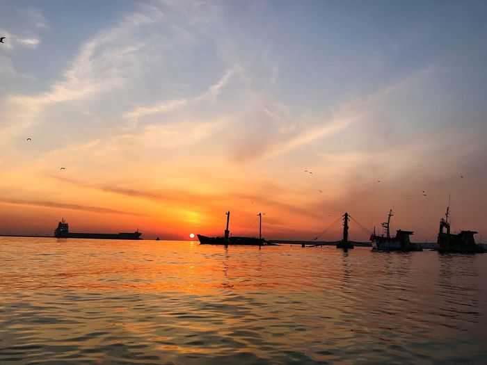 sunrise and cargo ship Water Sunset Sky Nautical Vessel Sea Transportation Scenics - Nature Cloud - Sky Beauty In Nature Silhouette Mode Of Transportation Nature Tranquil Scene Orange Color Tranquility Ship No People Sunlight Business Finance And Industry Outdoors