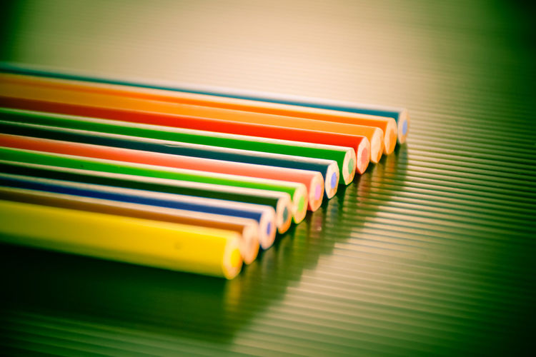 High angle view of multi colored pencils or crayons on table