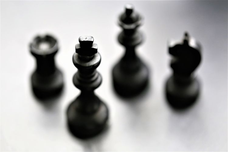 Chess Piece Indoors  Still Life Close-up No People Chess Leisure Games Game Board Game Leisure Activity Relaxation King - Chess Piece Queen - Chess Piece Arts Culture And Entertainment Medium Group Of Objects Group Of Objects High Angle View Pawn - Chess Piece Strategy Selective Focus Knight - Chess Piece Studio Shot Skill