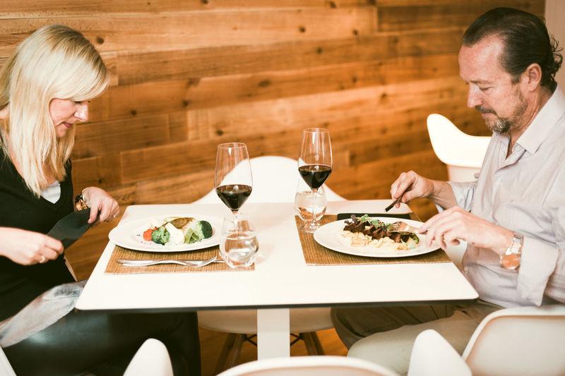 Couple Having Food In Restaurant
