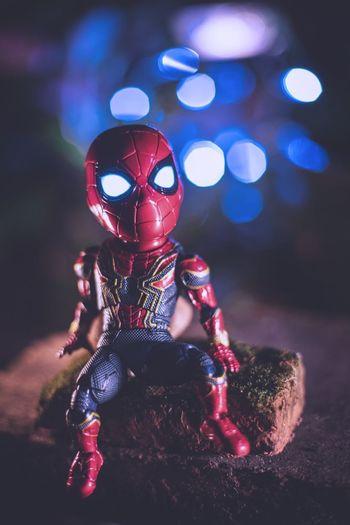 Close-up of figurine with illuminated toy