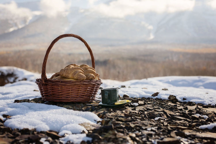 Cup, hot, tea, fresh, picnic, croissants, rocks, outdoors, mountain, snow, vacation, travel, freedom, holiday, enjoy