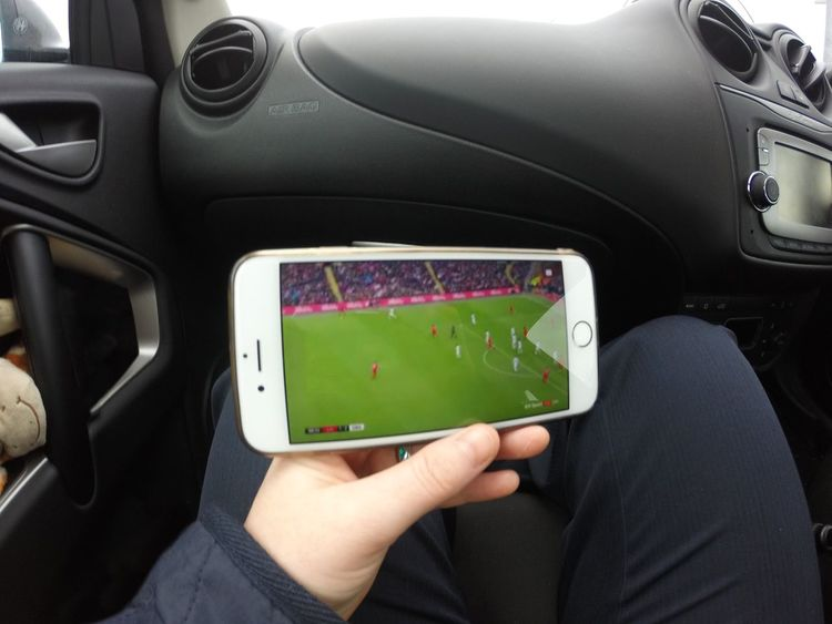 Watching Live Sport On A Mobile Phone Whiles In A Car (Passanger) Transportation Car Mode Of Transport Land Vehicle Vehicle Interior Human Hand Holding Technology Football Soccer Live Tv Live Sport Liverpool Football Club First Eyeem Photo FirstEyeEmPic Mobile Phone Mobile Device