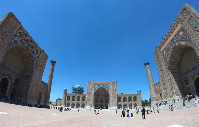 Fisheye view of Registan. Samarkand. Uzbekistan Outdoors Courtyard  Place Of Worship Belief Blue Crowd Large Group Of People Religion Clear Sky Travel Destinations Travel The Past History Group Of People Arch Tourism Building Exterior Built Structure Architecture Samarkand Samarqand Uzbek Uzbekistan Central Asia Silk Road Ex Soviet Countries Registan Unesco UNESCO World Heritage Site Historical Building Historical Monuments Tamerlan Timur Tourism Destination Scenics Madrasah