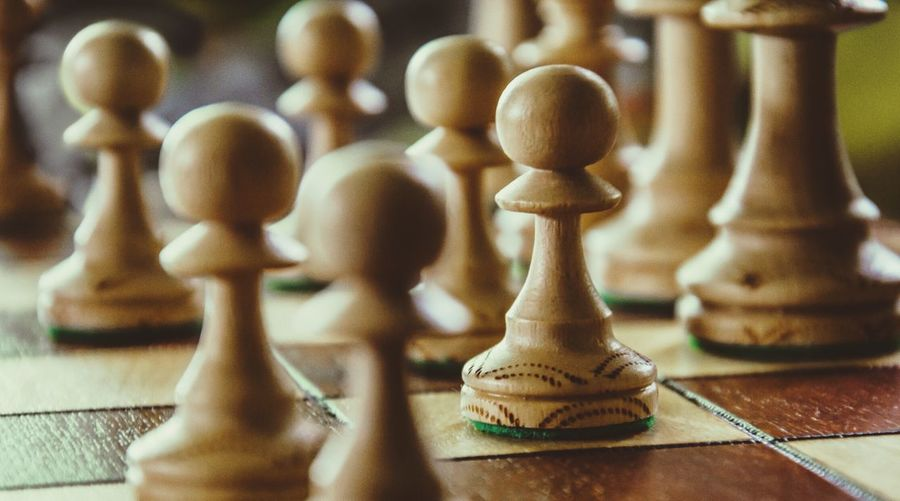 Close-up of chess pieces on board
