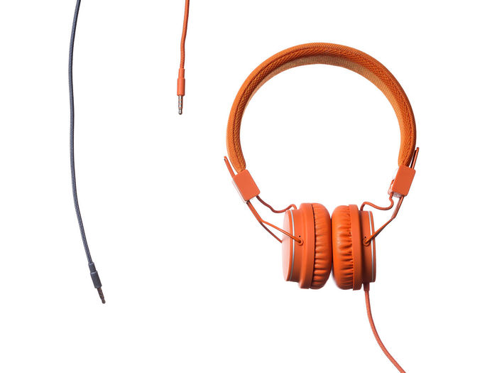 Orange Headphones on white Background Cable Close-up Communication Computer Cable Connection Day Headphones Indoors  Network Connection Plug No People Product Product Photography Red Sound Studio Shot Technology White Background