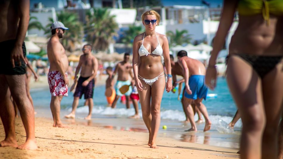 A nice 👙girl is walking through the most famous and very crowded beach on the island in Naxos Greece Beach Bikini Swimwear Summer Vacations Water Swimming Pool Agia Anna Beach Life Naxos Beach Naxos Greece Cyclades Crowded Beach High Season Large Group Of People Outdoors Sand People Sea Famous Music Beaches Swimsuit White Live For The Story Sommergefühle Sommergefühle My Best Travel Photo