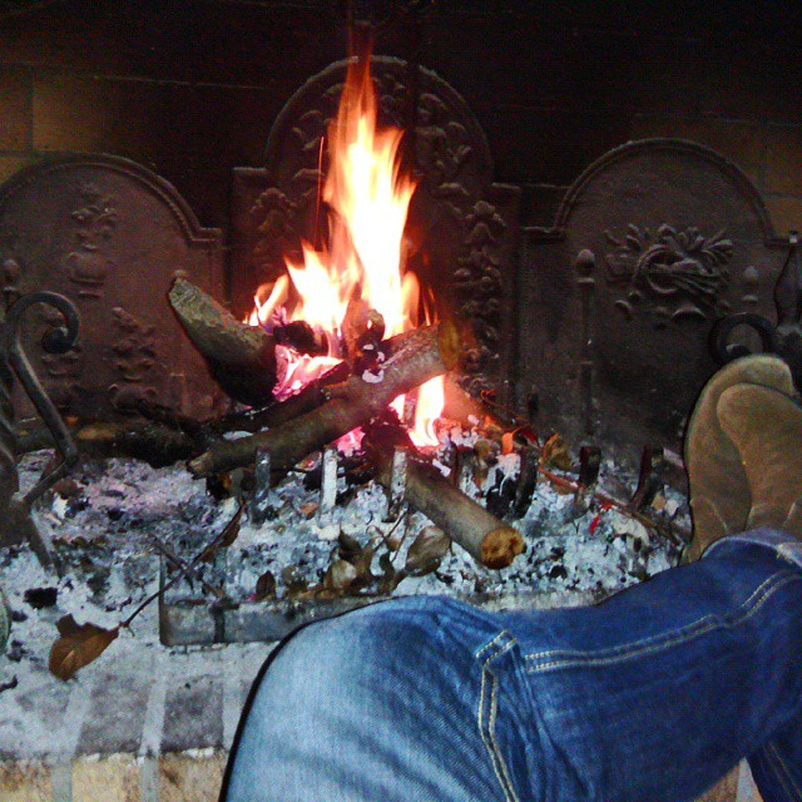 burning, flame, fire - natural phenomenon, heat - temperature, night, illuminated, men, lifestyles, glowing, leisure activity, standing, fire, orange color, firewood, unrecognizable person, bonfire, indoors