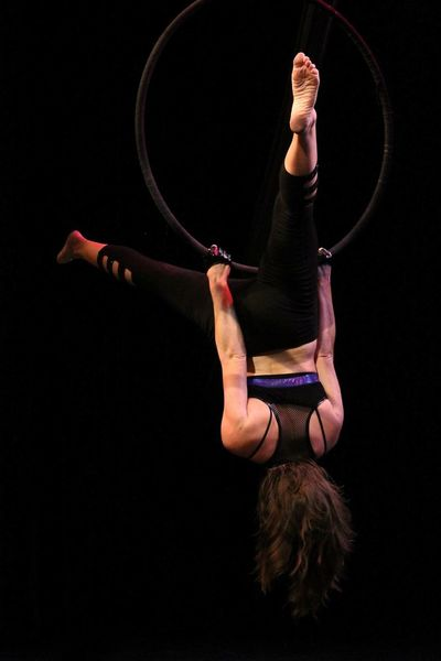 Aerial Lyra Circus Lyra Aerial Hoop Aerial EyeEm Selects Plastic Hoop Black Background Skill  Acrobat Balance Performance One Person Hanging Young Adult Adult Agility Flexibility Practicing Expertise