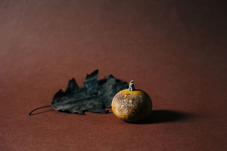Close-up of orange fruit on table