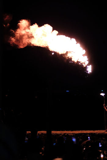 Silhouette of fire at night