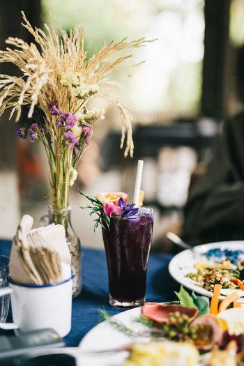 น้ำดอกอัญชัญ Table Food And Drink Vase Food Freshness Flowering Plant Flower Still Life Indoors  Focus On Foreground Close-up Selective Focus No People Plant Household Equipment Container Nature Glass Drink Drinking Glass