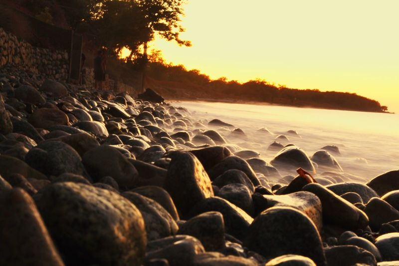 Campinglife Nature Beauty In Nature Sunset No People Beach Pebble Outdoors Pebble Beach Sea Water Sky
